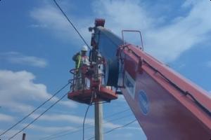 Рабочий люльки на строительной вышке (ПБ 10-611-03)